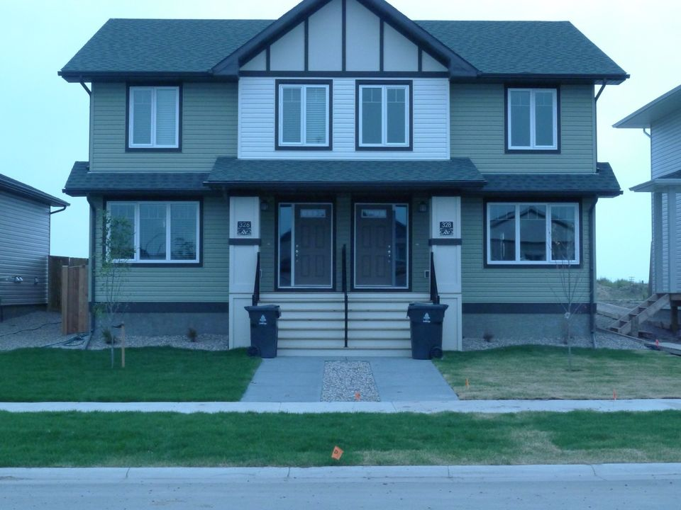 West Lethbridge 1/2 Duplex: 2 Years Old with New Home Warranty