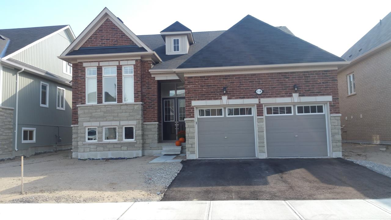 Amazing Raised Bungalow!  Almost New!