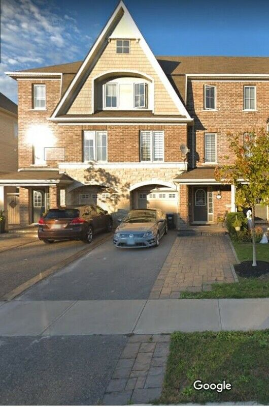 Freehold 2,200 sq ft Executive Townhouse, Ravine View